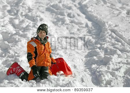 Cute Boy With Wool Cap In The Winter Plays With Bob In The Mountains