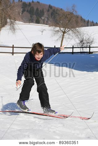 Inexperienced Boy Trying The Cross-country Skiing