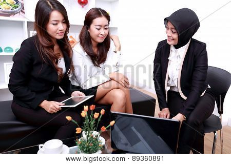A Group Of Businesswomen Meeting At Office Livingroom