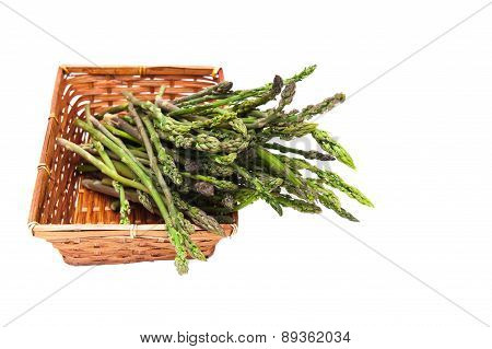 Basket With Bunch Of Asparagus Isolated Selective Focus On Head