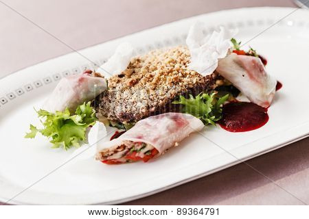 meat with spring rolls