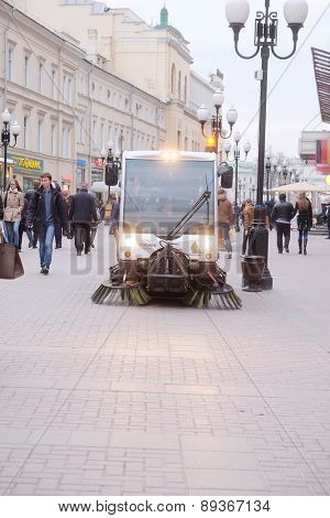 MOSCOW, RUSSIA - APRIL 22, 2015: Sweeping machine cleans the street in Moscow