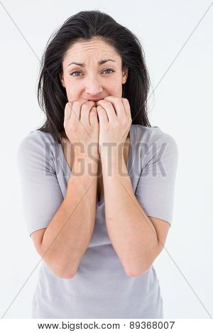 Depressed woman looking at camera on white background