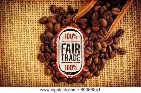Fair Trade graphic against wooden shovel with coffee beans