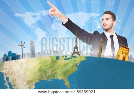 Thoughtful businessman pointing his finger against bright blue sky