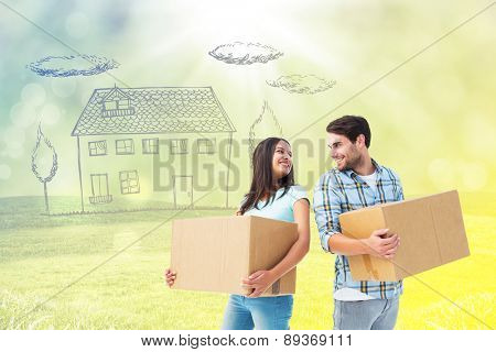 Happy young couple with moving boxes against field with glowing sky