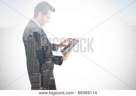 Businessman standing while using a tablet pc against new york