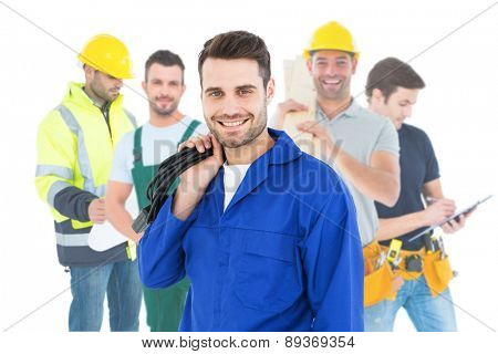 Composite image of smiling repairman holding cable