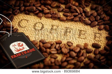 Fair Trade graphic against coffee beans surrounding coffee stamped on sack
