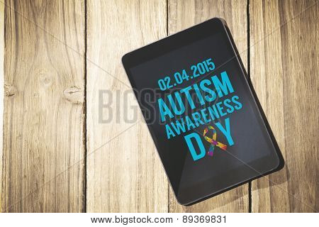 Autism awareness day against overhead of tablet on desk