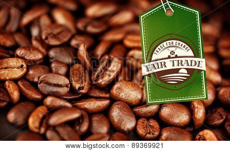 Fair Trade graphic against beans of coffee laid out together