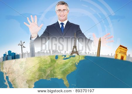Businessman presenting against bright blue sky