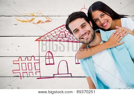 Happy casual man giving pretty girlfriend piggy back against white wood