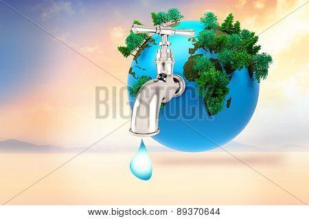 Earth with faucet against desert landscape