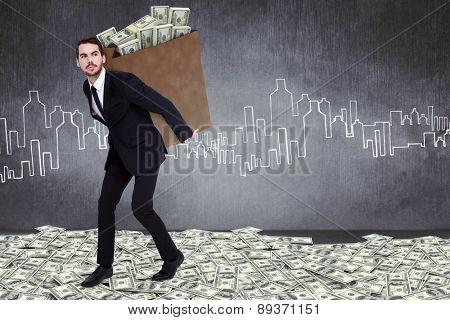 Businessman carrying bag of dollars against hand drawn city plan