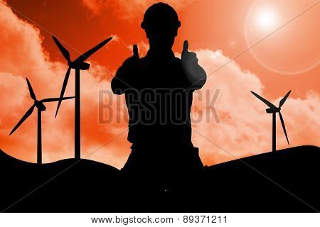 Happy repairman gesturing thumbs on white background against sky and mountains