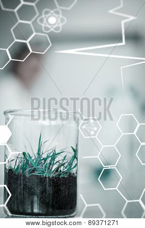 Science and medical graphic against close up of a young plant on table at lab
