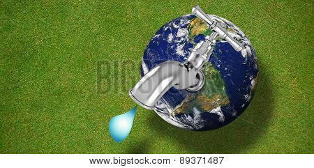 Earth with faucet against green background