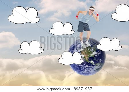 Geeky hipster posing in sportswear against beautiful blue sky with clouds