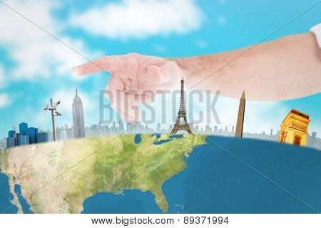 Businessmans hand pointing in shirt against blue sky