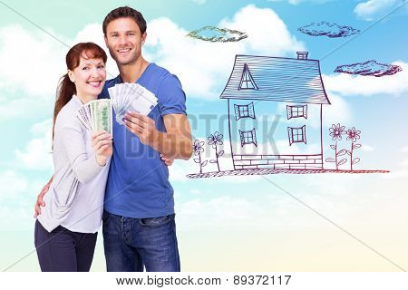 Couple holding fans of cash against blue sky