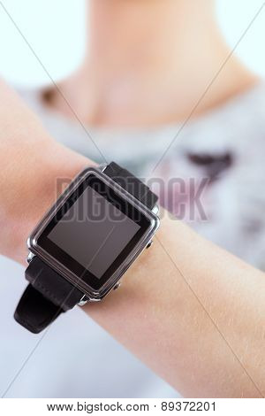 Woman wearing her smartwatch on white background