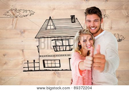 Attractive couple showing thumbs up to camera against bleached wooden planks background