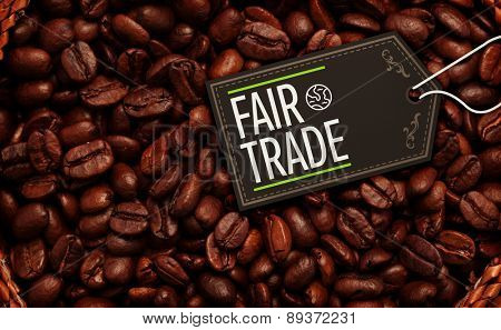 fair trade against close up of a basket full of dark coffee beans