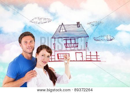 Couple holding keys to home against painted sky