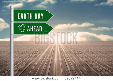 earth day ahead against wooden planks leading to blue sky