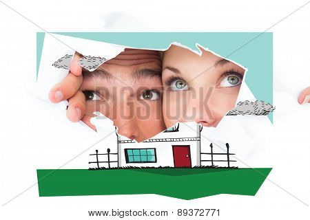 Young couple peeking through torn paper against white background with vignette