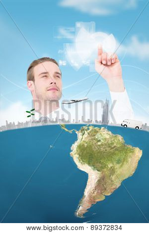 Cheerful businessman pointing with his finger against blue sky