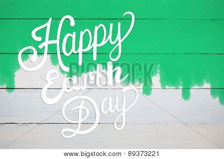 Earth Day Graphic against green paint on fence