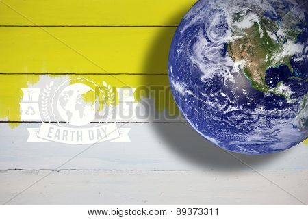 earth against yellow paint on fence