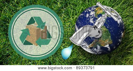 Earth with faucet against grass background
