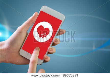 Hand holding smartphone against futuristic background with lines
