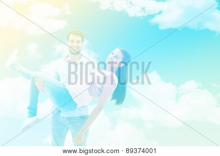Attractive young couple having fun against blue sky