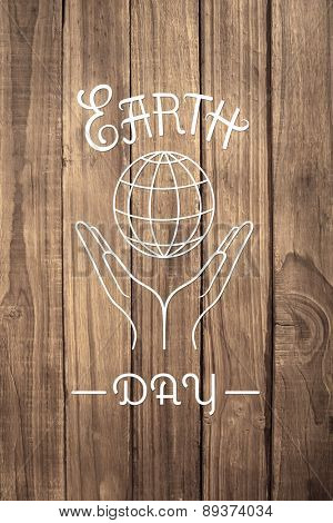 Earth Day Graphic against overhead of wooden planks