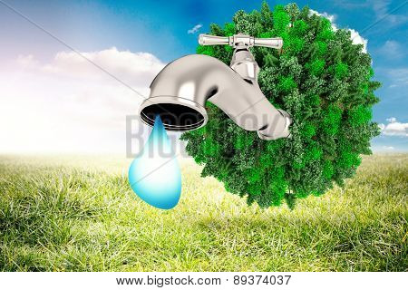 Earth with faucet against sunny landscape