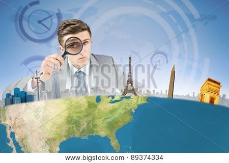 Businessman with magnifying glass against blue and purple sky