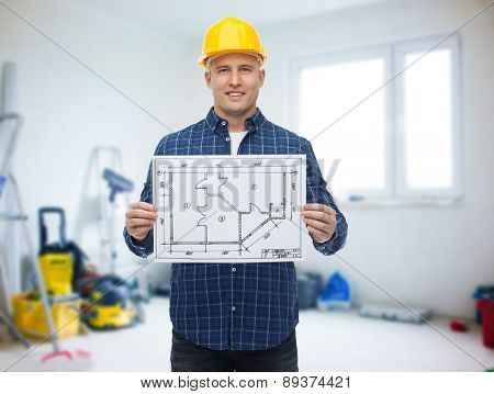 repair, construction, building, people and maintenance concept - smiling male builder or manual worker in helmet showing blueprint over room with work equipment background