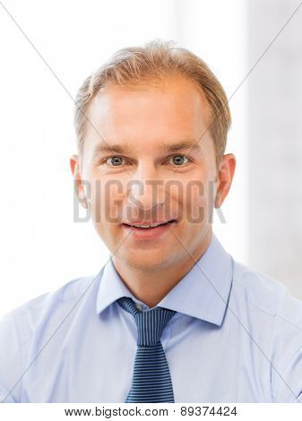 smiling middle-aged businessman in office