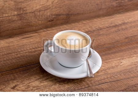 White Cup Of Delicious Aromatic Freshly Prepared Cappuccino