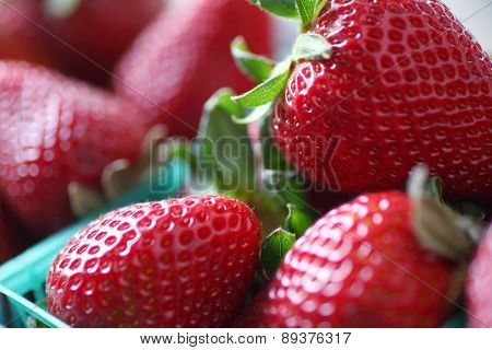 Strawberries in plastic baskets