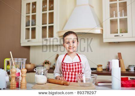 Cute girl going to make dough