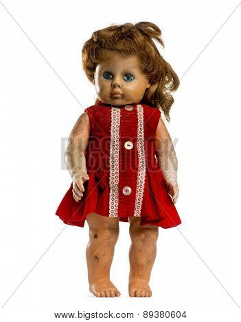 Used dressed doll  in front of a white background
