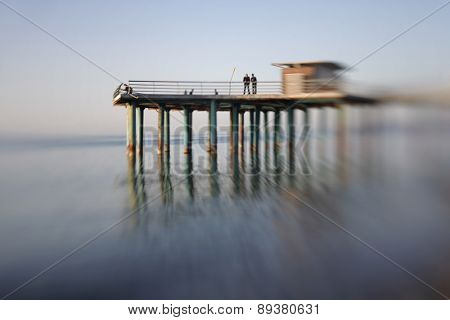 Pier in sea water. Soft focus. Made with lens-baby.