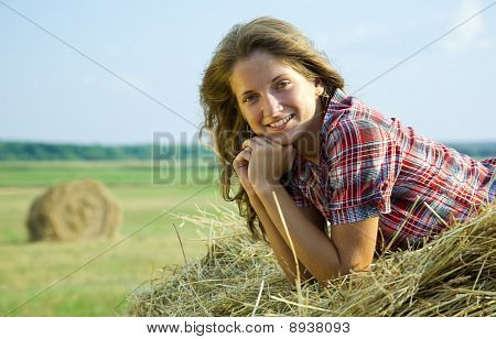 Girl Laying Hay Bail