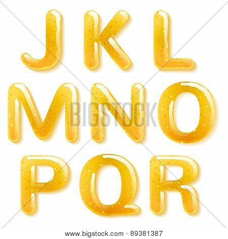 Yellow honey jelly alphabet. Glossy letters.