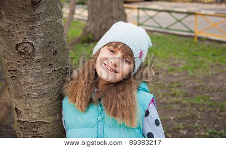 Smiling little girl in a park